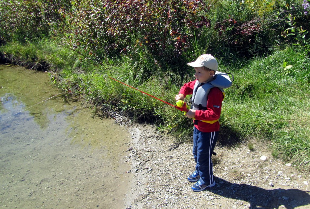 My four-year-old son reeling in a sunfish